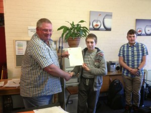 Kelvin receives Grade 4 music certificate